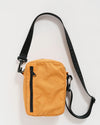 apricot colored nylon crossbody bag with a 45 inch strap