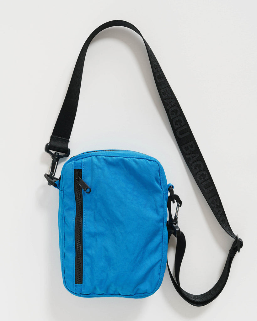 pool colored nylon crossbody bag with a 45 inch strap