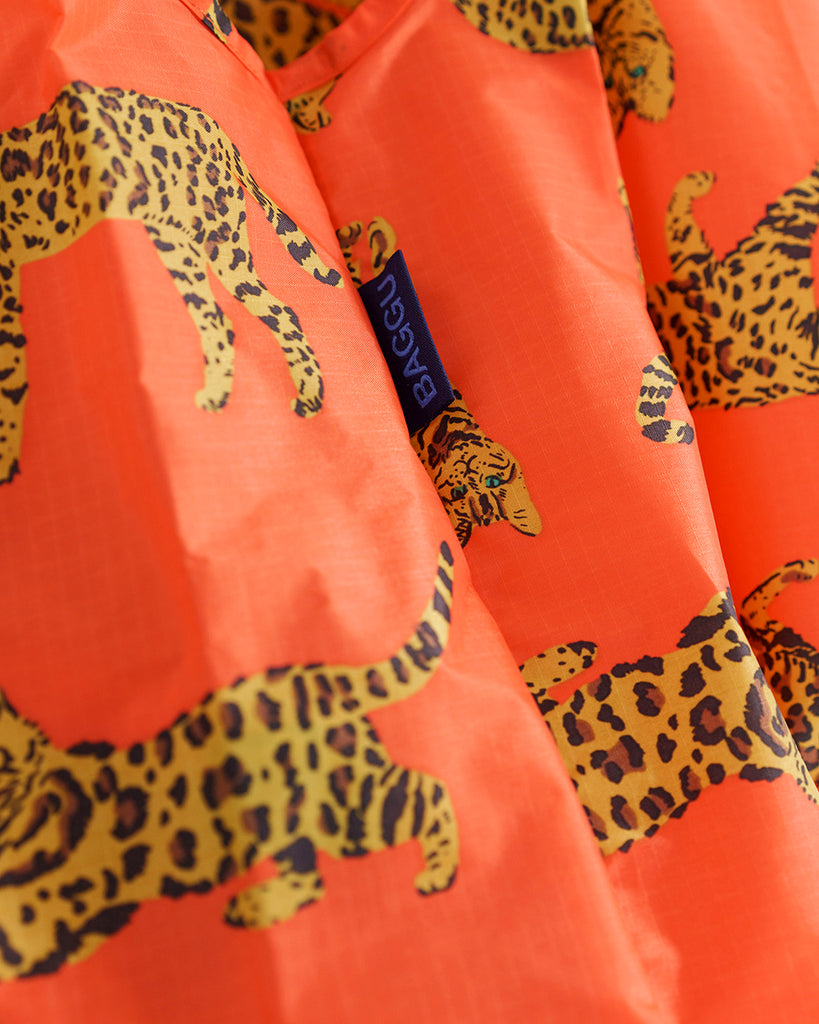 Detailed shot of bright orange color and bengal cat design