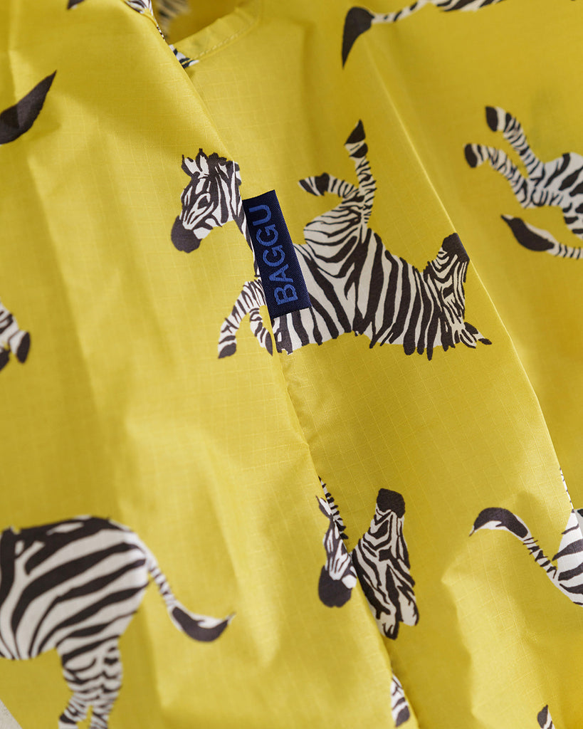 Detailed shot of bright yellow bag with zebras