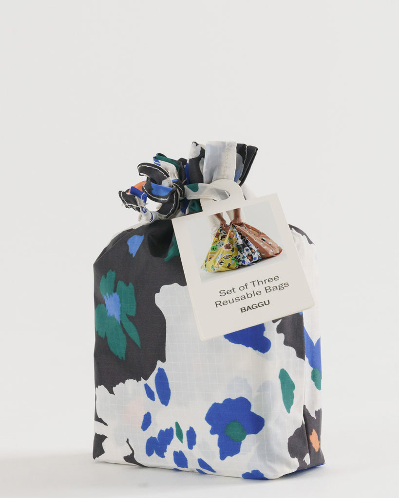 black and white with blue and orange floral print baggu bag carrying pouch