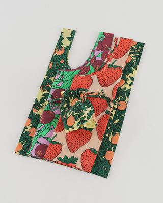 set of 3 standard baggu bags in 3 different fruit themed patterns: strawberry, orange, plum with matching pouch in orange pattern