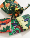folded set of standard baggu bags in 3 different fruit themed patterns: strawberry, orange, plum with matching pouch in orange pattern