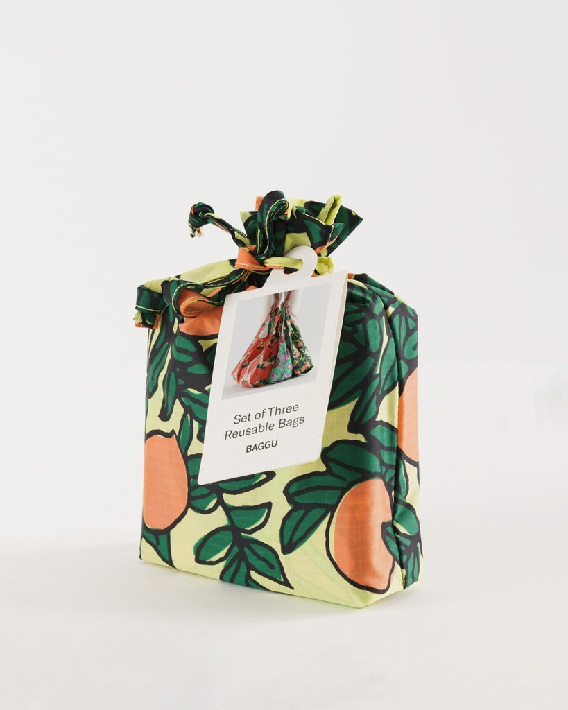 orange patterned pouch containing set of 3 baggu bags