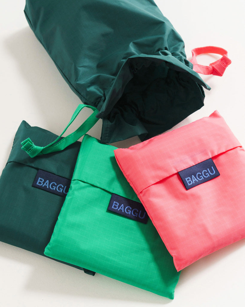 set of 3 folded baggu bags in teal, turquoise, and pink with matching pouch