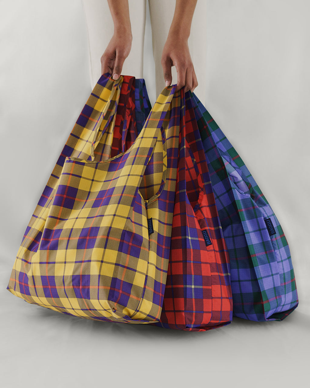 Set of 3 standard baggus in plaid prints.