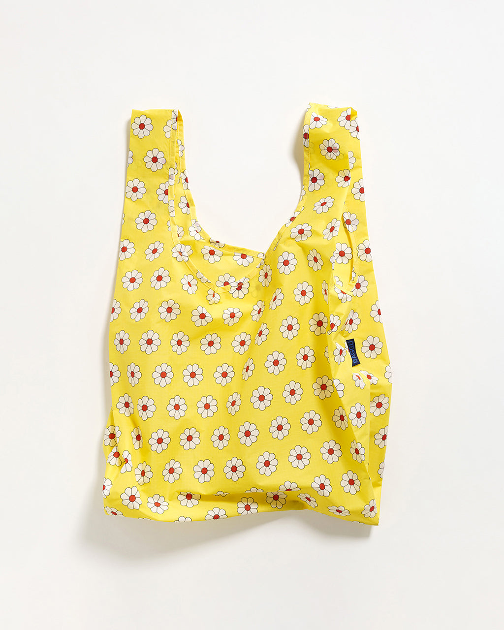 yellow nylon bag with red and white flowers in a repeating pattern