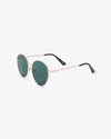 side view of oversized round sunglasses with a dark green lens and a thin frame