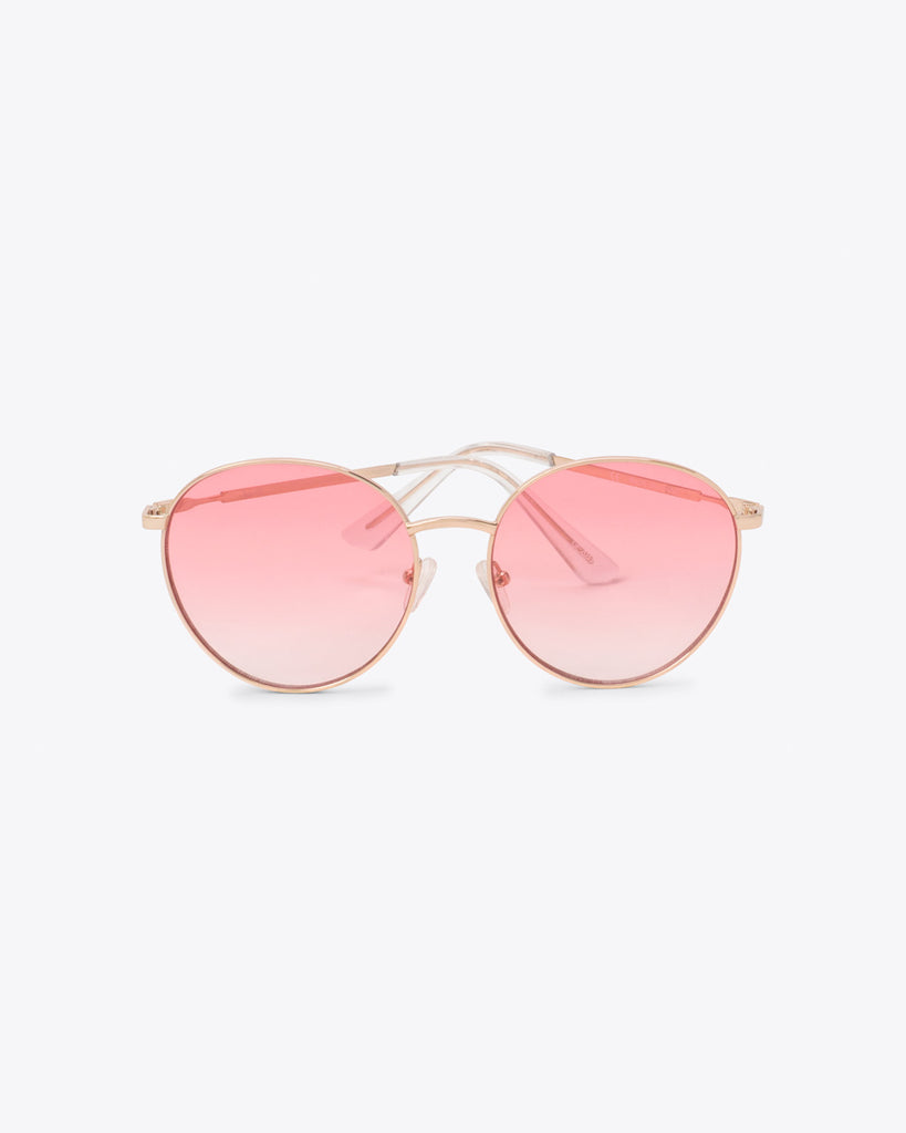 Oversized round sunglasses with pink lens with a thin frame