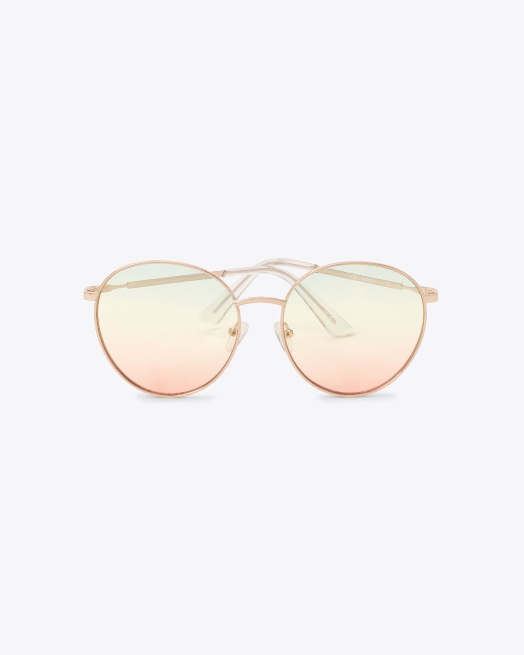 Oversized round sunglasses with lightly tinted rainbow lens and a thin frame
