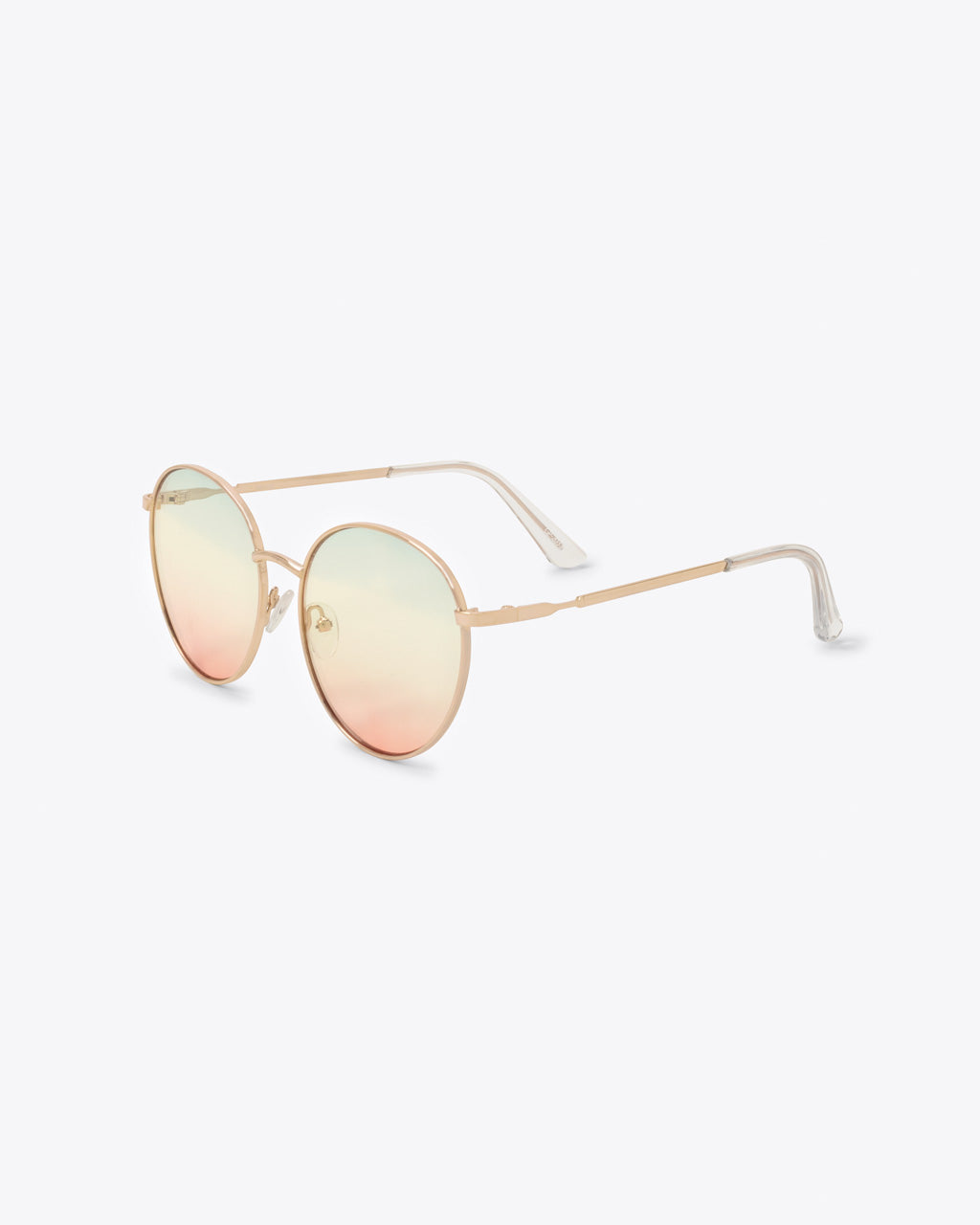 side angle view of oversized round sunglasses with lightly tinted rainbow lens