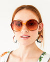 woman wearing oversized amber sunglasses