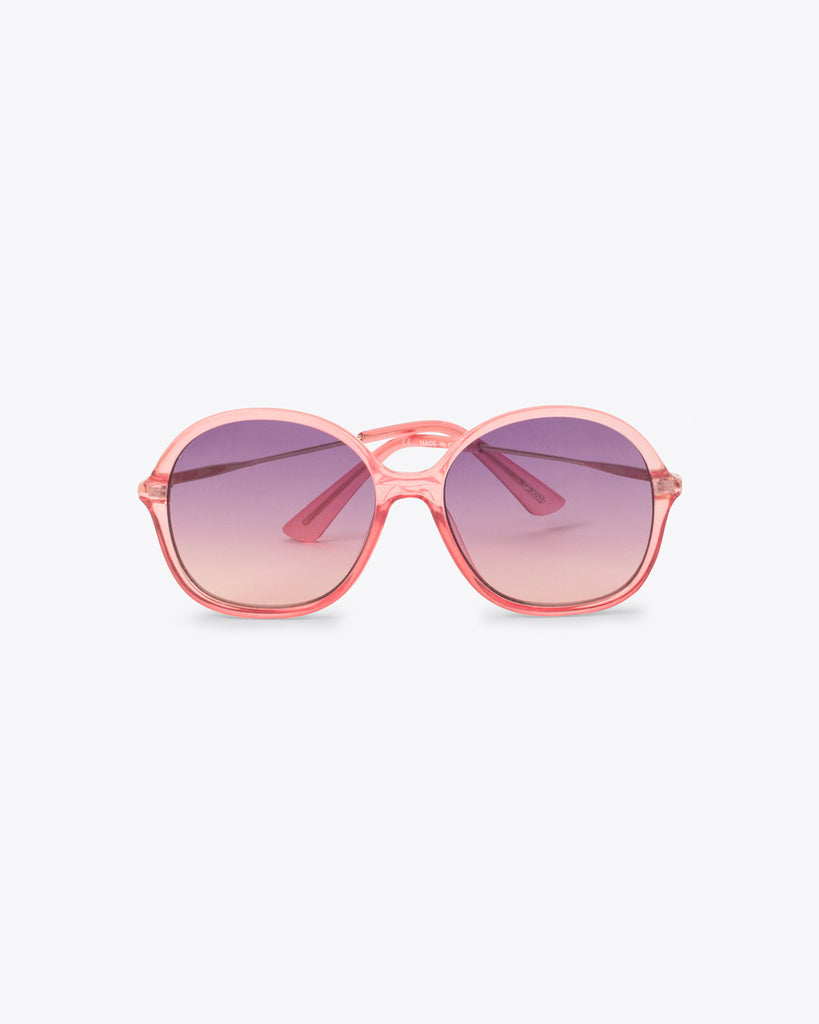oversized vintage sunglasses with a pink tint frame and an ombre pink lens