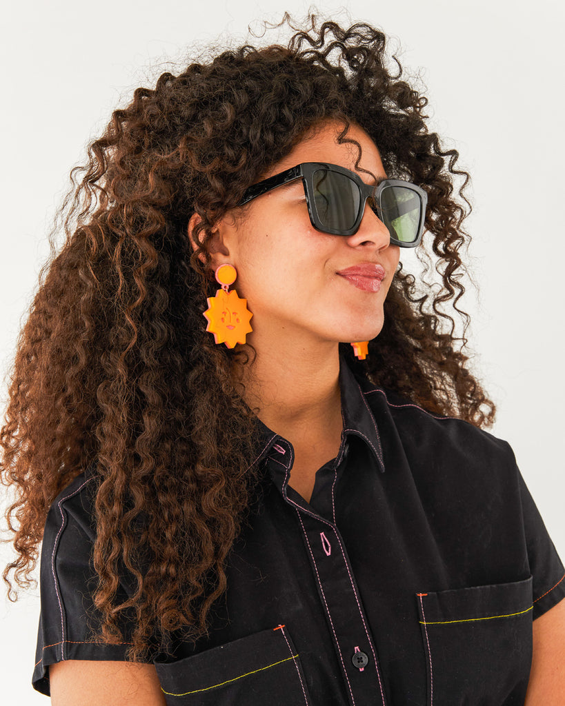 side angle of black square sunglasses shown on model