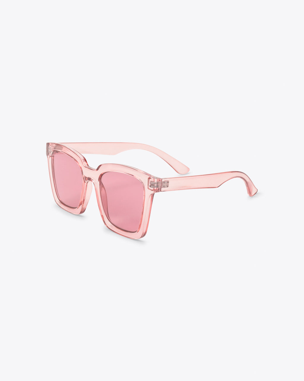 side view of square sunglasses with translucent pink frames and pink lenses
