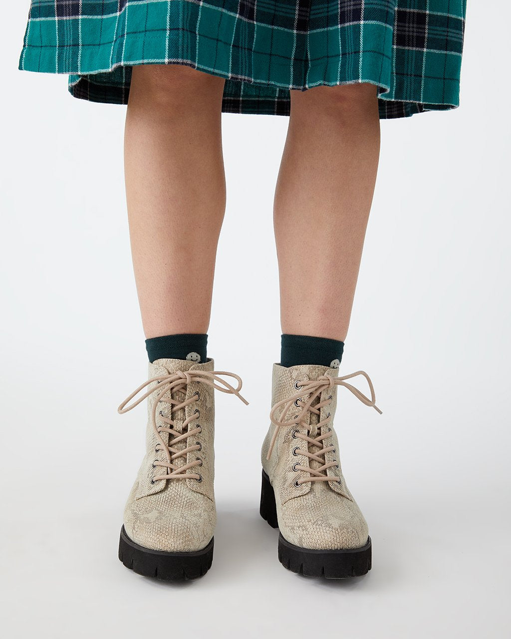 Faux snakeskin print lace up boots.