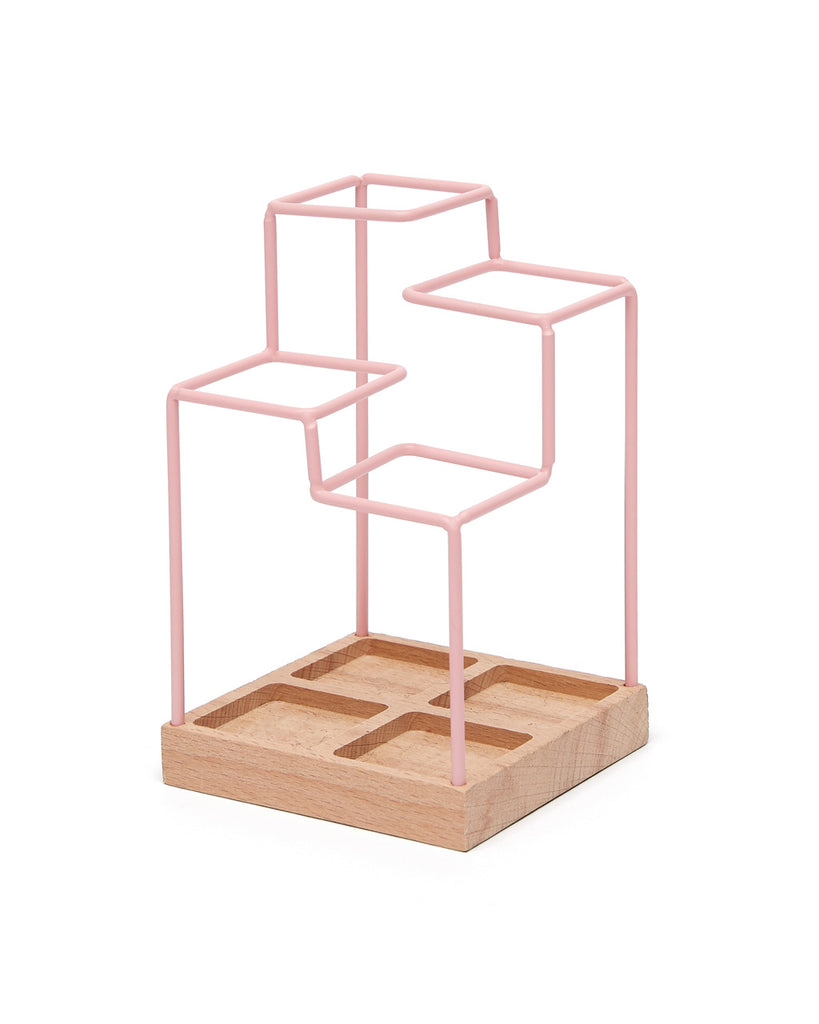 This Pencil Organizer by Block comes in pink, with natural wood accents.