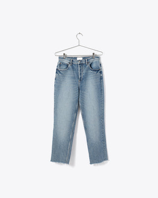 medium wash blue jeans with a straight leg fit and raw hem
