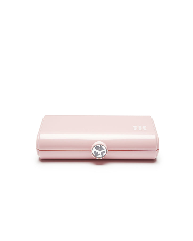 Small pink rectangular makeup case by Caboodles.