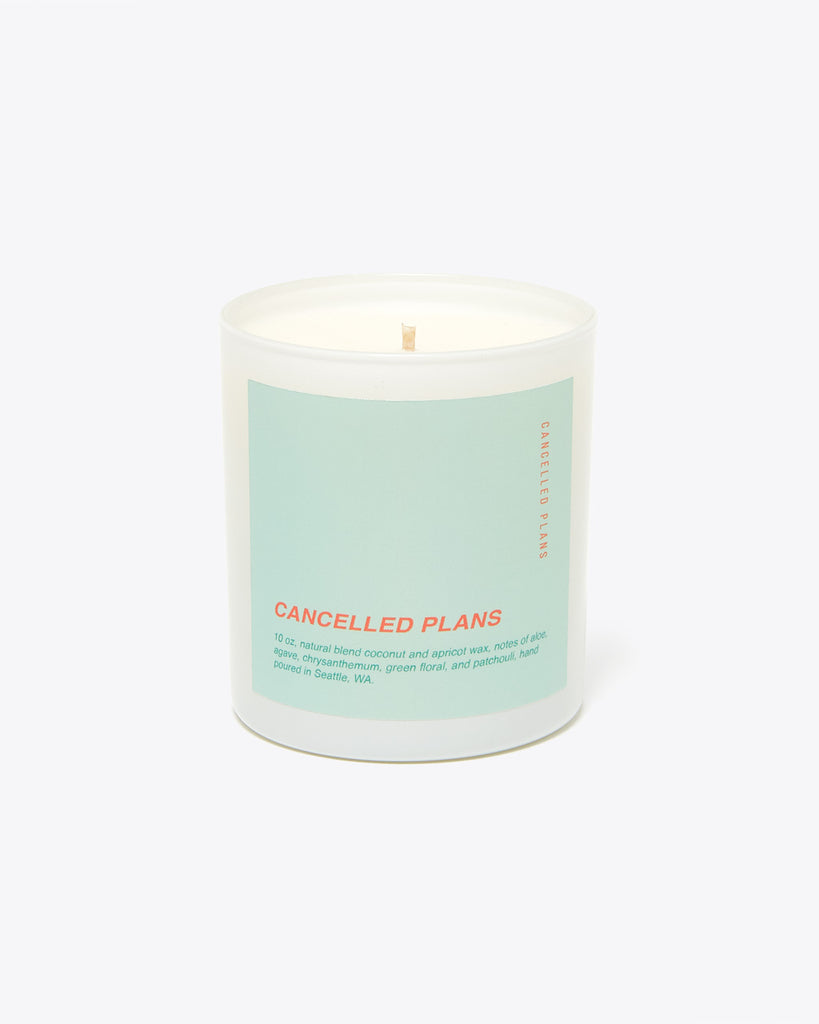 white 10 ounce candle with a mint colored label