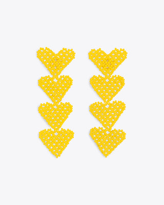 yellow heart drop earrings with 4 hearts on each one