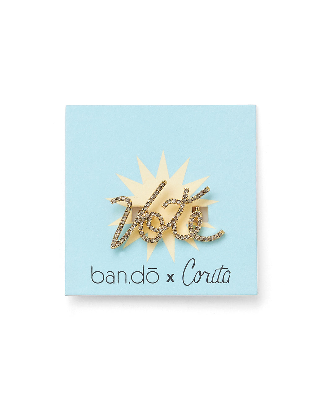 vote pin in cursive font with jewels all over shown on blue backer card