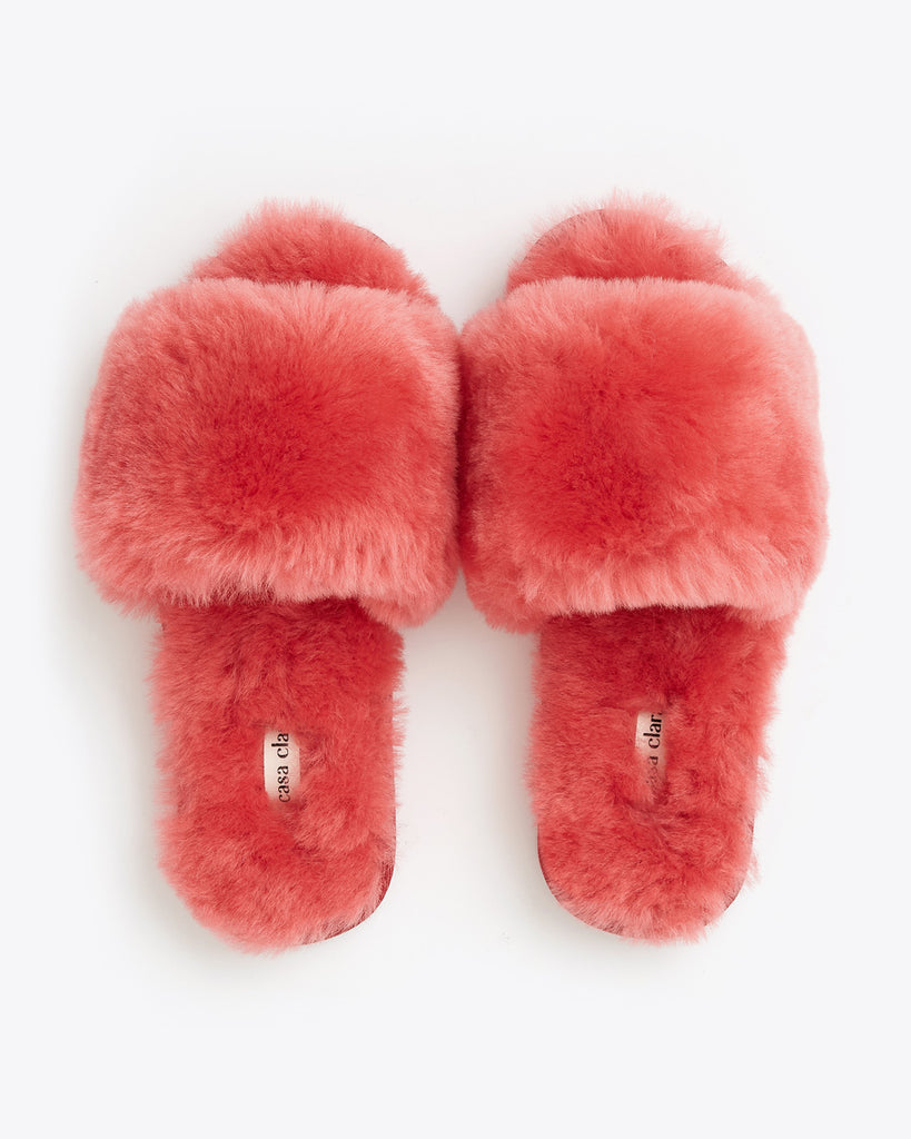 flat lay of faux red fur slippers