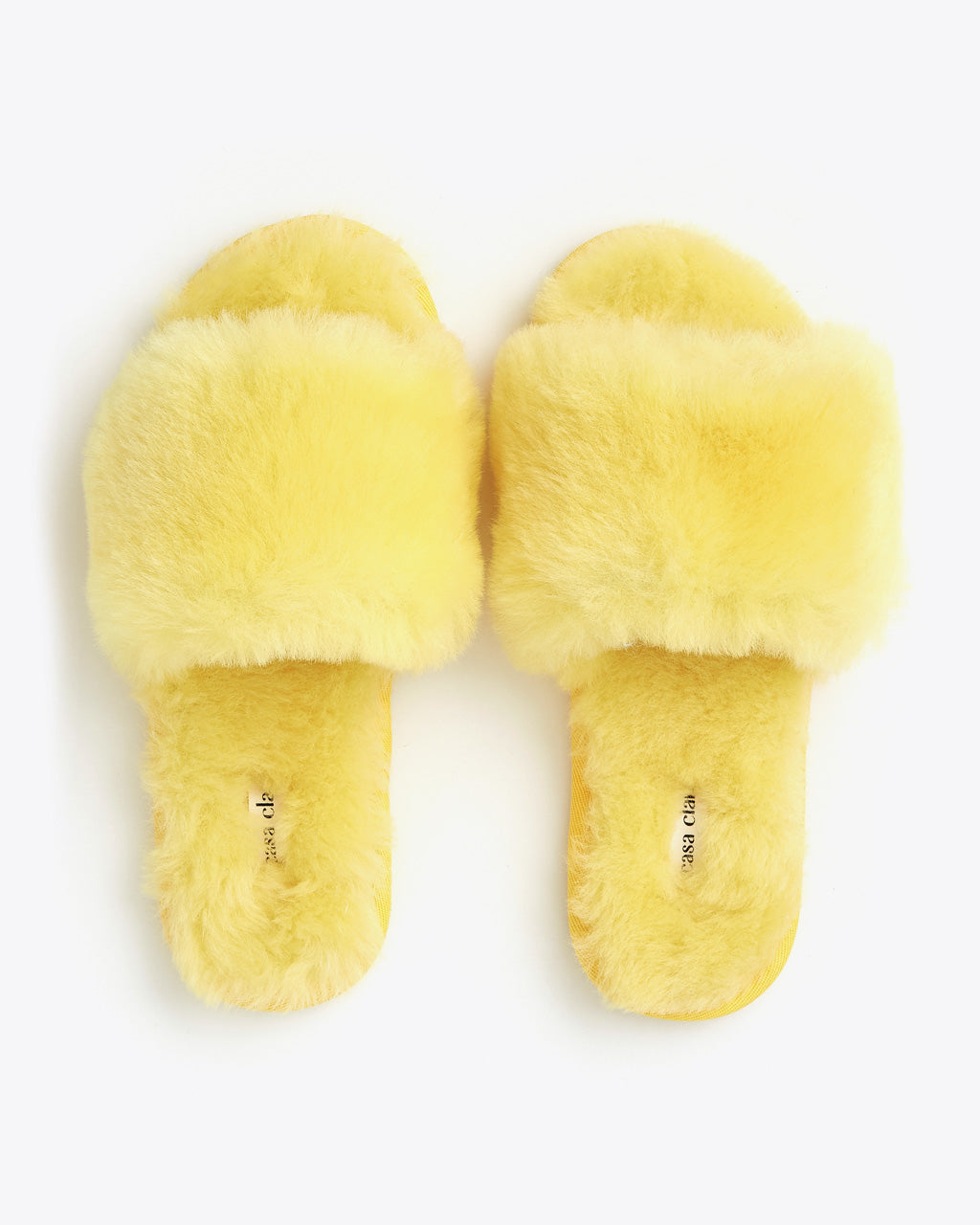 flat lay of faux fur yellow slippers