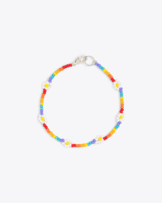 rainbow colored beaded bracelet with daisy accent bead design