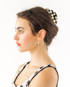 gold hoops shown on brunette model with hair pulled back