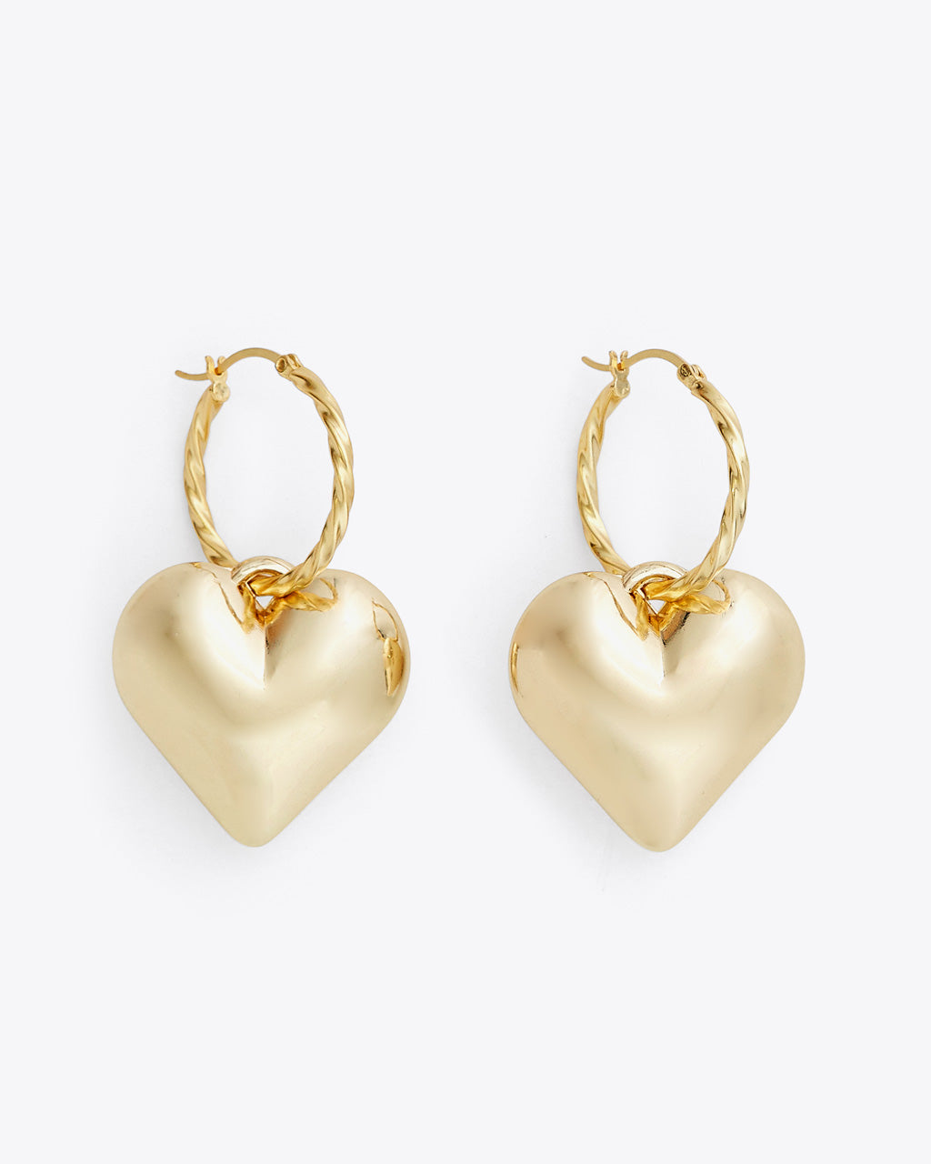 gold hoops with chunky heart studs