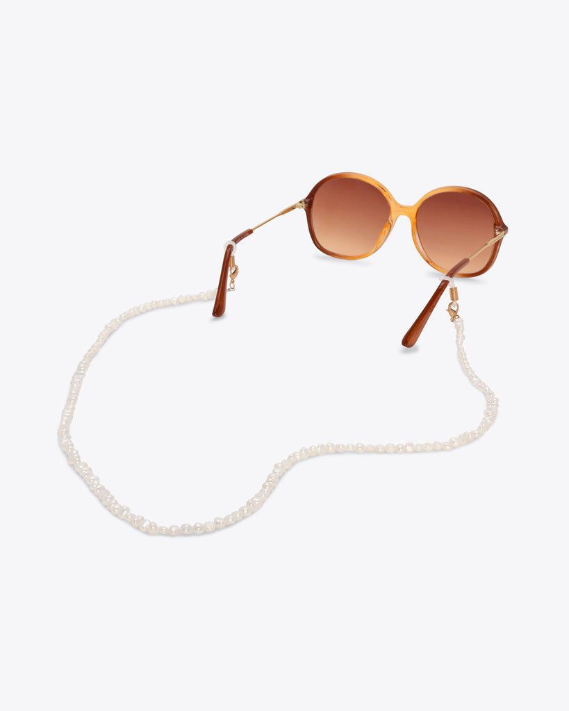 freshwater pearl accessory chain shown on sunglasses