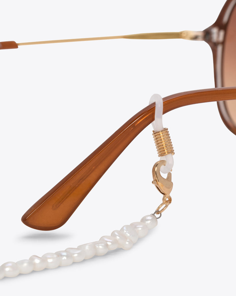 detailed image of freshwater pearl chain shown on sunglasses