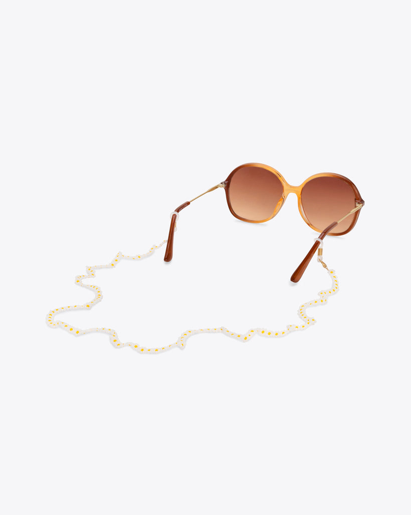 white daisy accessory chain shown on sunglasses