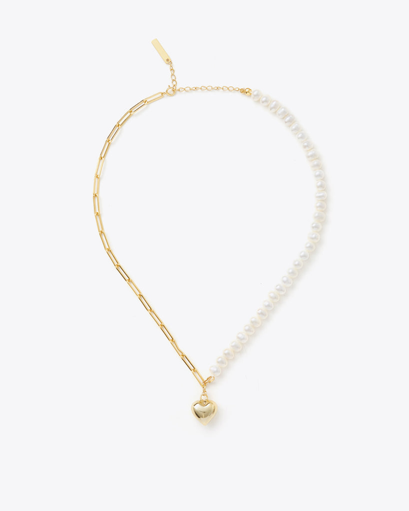 gold and pearl bracelet with a heart charm