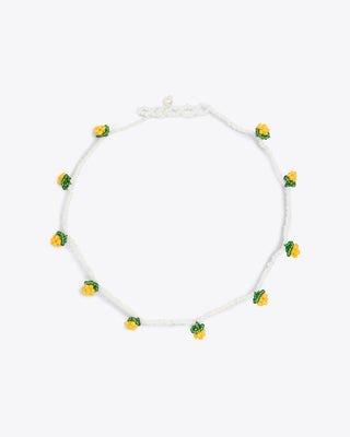white beaded choker necklace with yellow and green bead accents