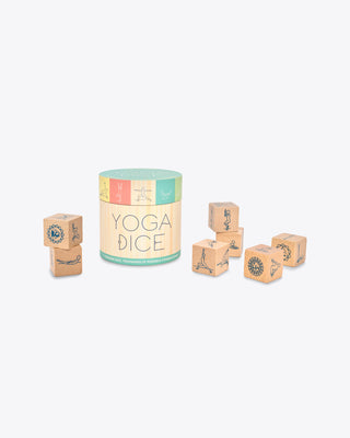 wooden dice each containing different yoga poses