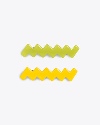 2 zig zag hair clips, one yellow and one green