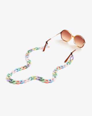 pastel rainbow colored accessory chain shown on sunglasses