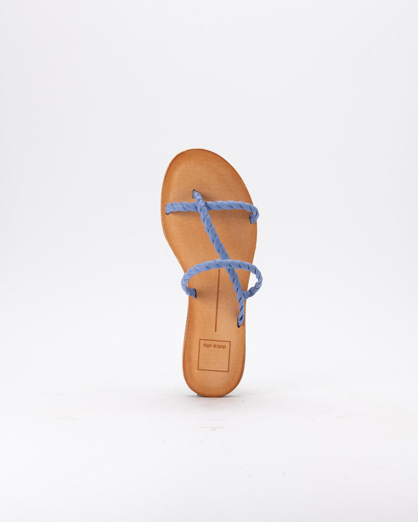 overhead view of flat sandal with brown leather sole and blue braided straps