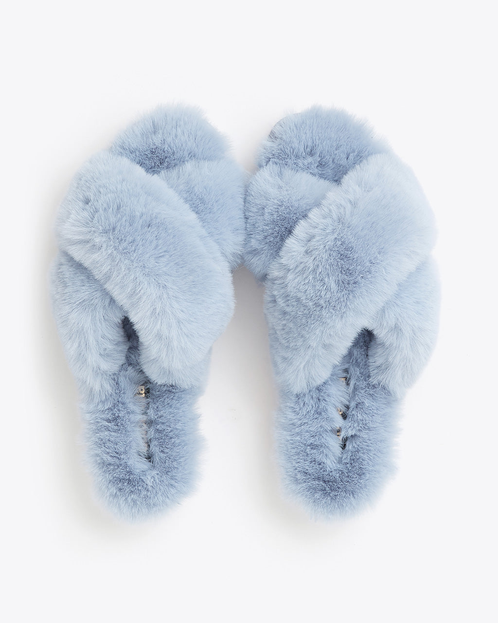 flat lay of blue faux fur slippers