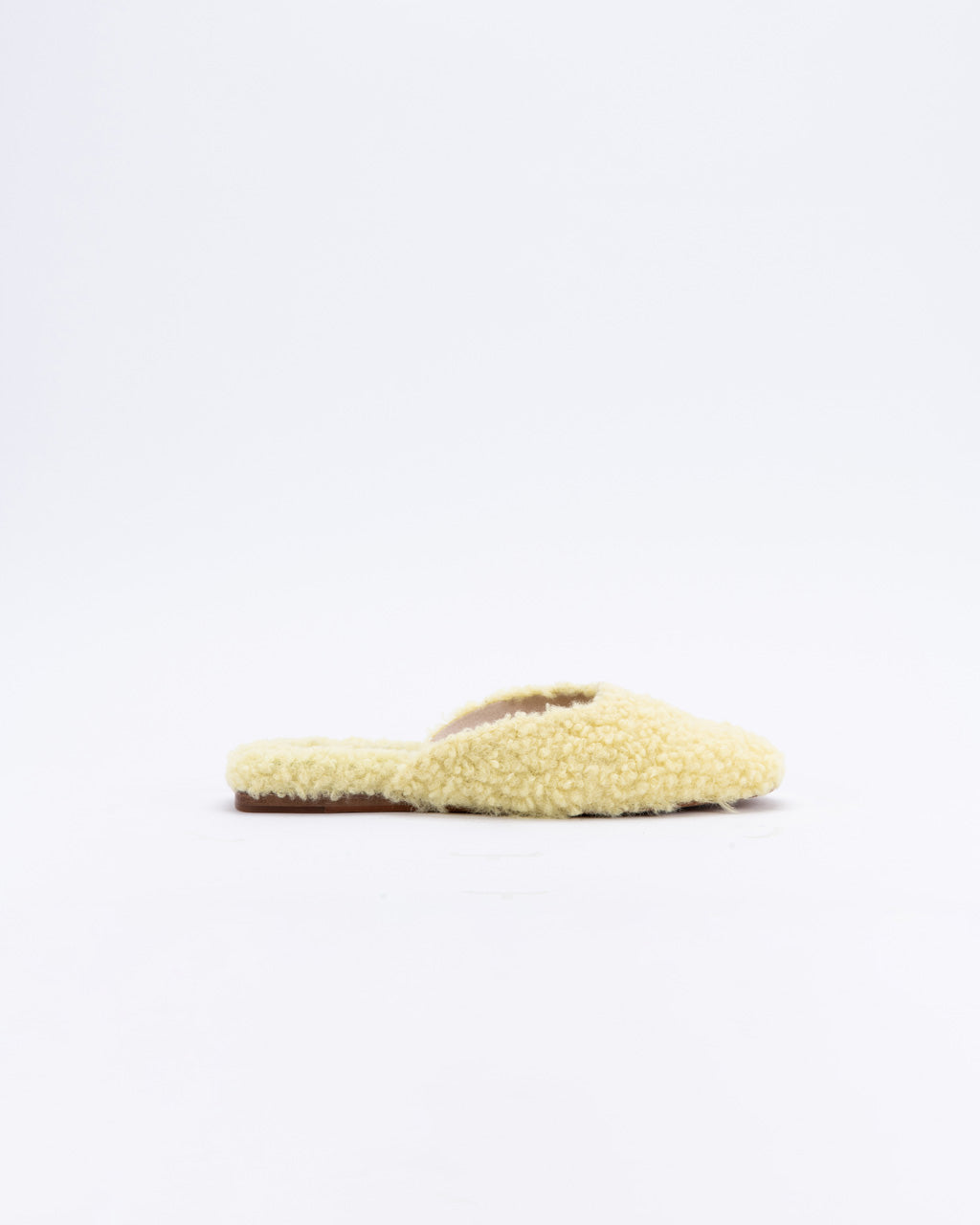 side view of sherpa flat mule slide in light yellow