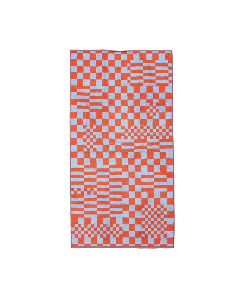 Two-tone reversible cotton towel with a checkerboard print.