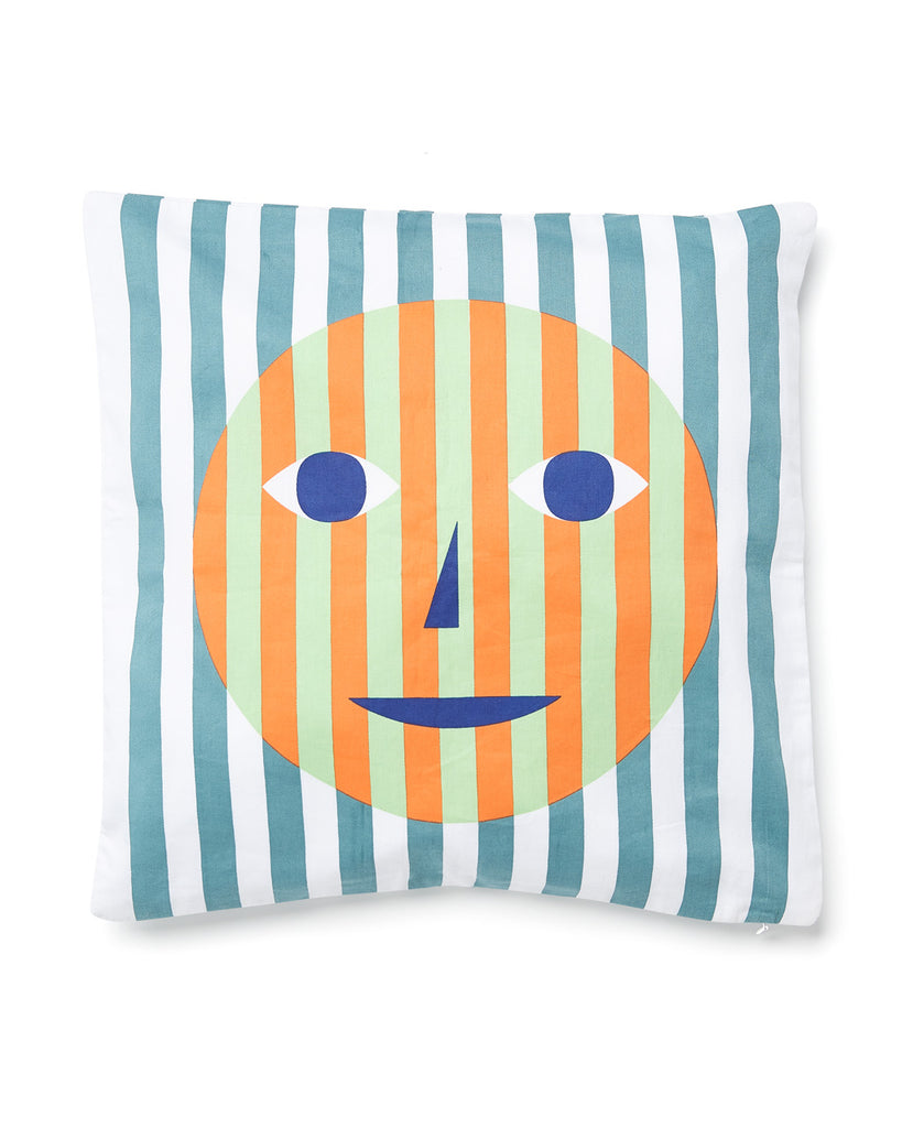 Smiley face screen printed pillow with vertical blue stripes.