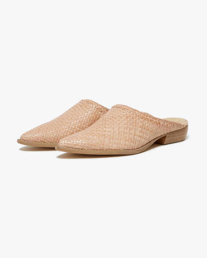 blush colored mules with a textured matieral