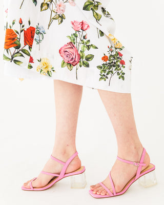 pink strap heels with a clear block heel shown on model