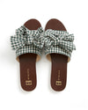 top view of green gingham slide sandals