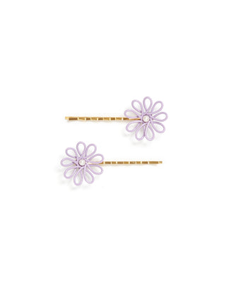 Front shot of lilac flower barrette with a pearl center and gold bobby pin base.