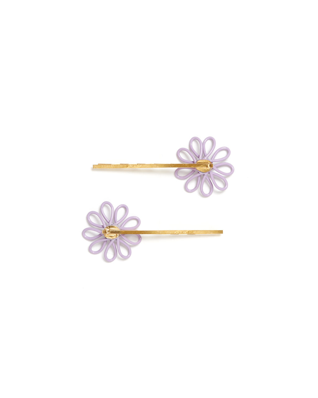Back shot of lilac flower barrette with a pearl center and gold bobby pin base.