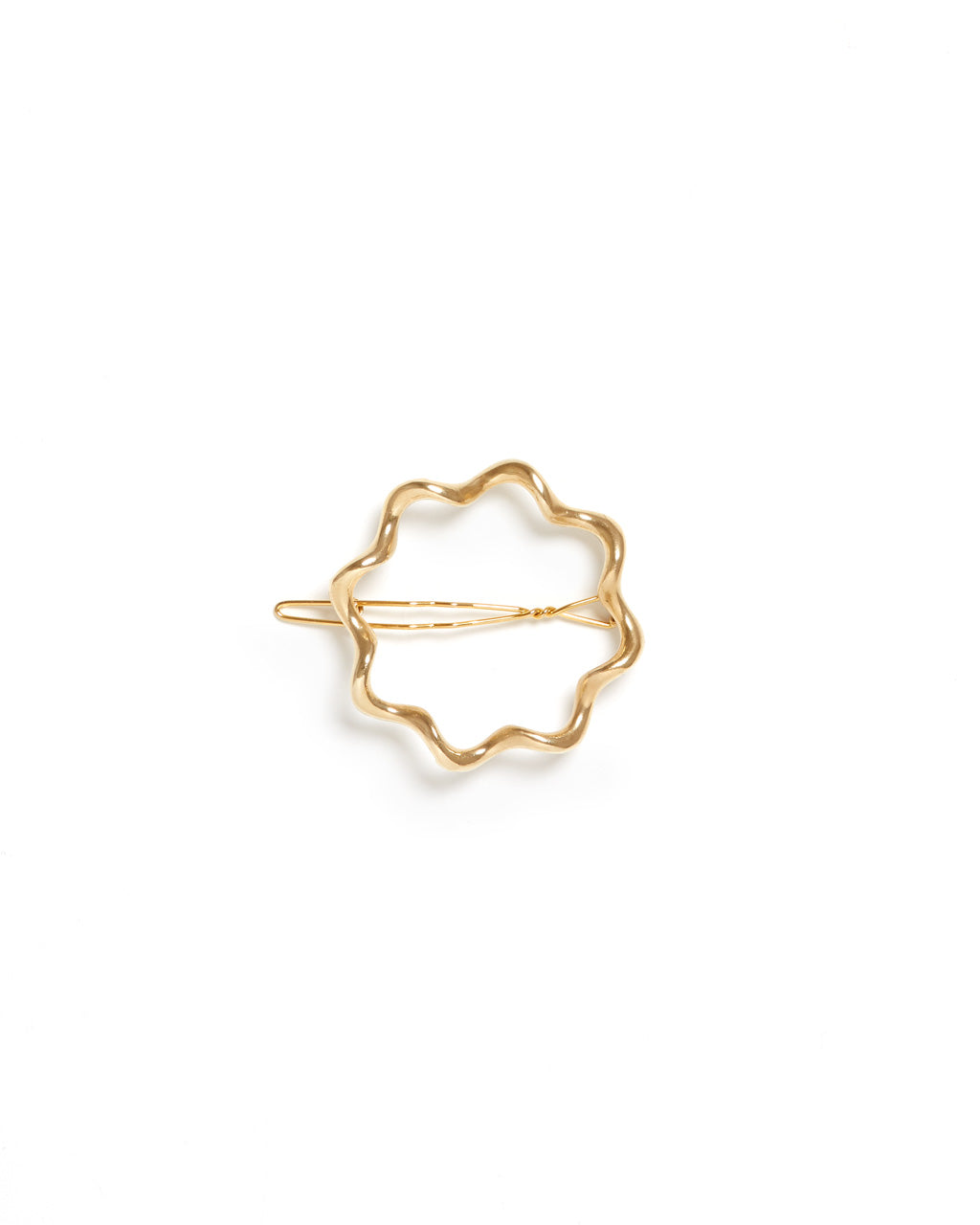 medium sized gold barrette with a unique shape